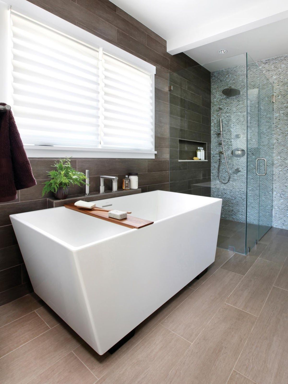 this modern style bathroom with glass shower and geometric bath  - cool greybrown tones and geometric lines paired with dark bamboo accentsand handcrafted glass tile are the foundation for a chic contemporary bath
