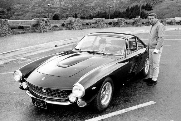 Steve McQueen outside his 1963 Ferrari 250 GT Lusso.