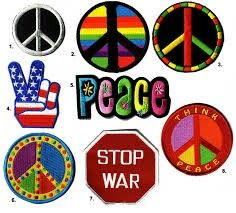 Patches that say peace stop war and multi colored peace signs