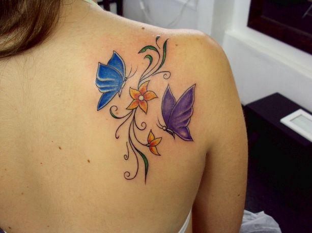 Tatuagem Borboleta Flores Galhos Colorida Costas