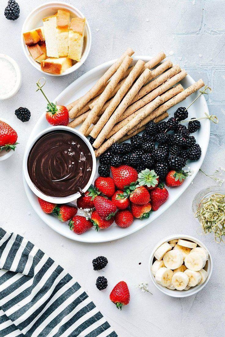 Easy Chocolate Fondue @FoodBlogs #easy #chocolate #dessertfoodrecipes #fondue #d...   - Fondue Recipes #chocolatefondue #fonduerecipe #easyfondue #chocolatefonduerecipes