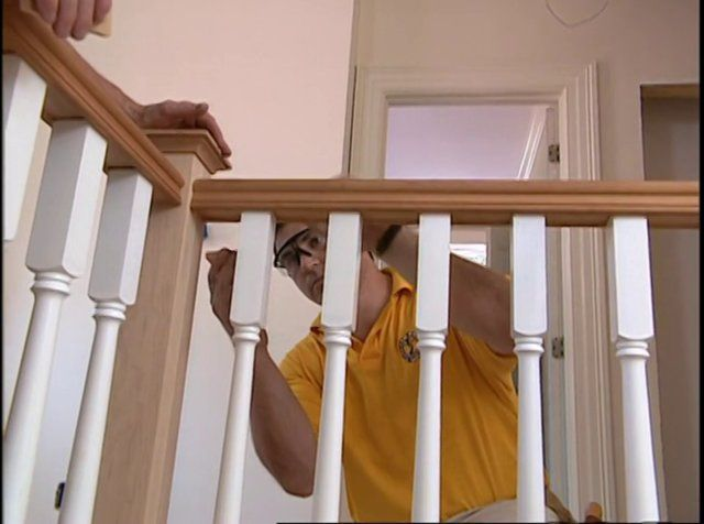 Installing Stair Handrails And Balusters. As Contractors Install The Stair  Railing And Balusters, Carpenter