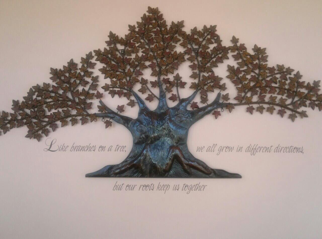 On our living room wall bought this large metal tree art and had a
