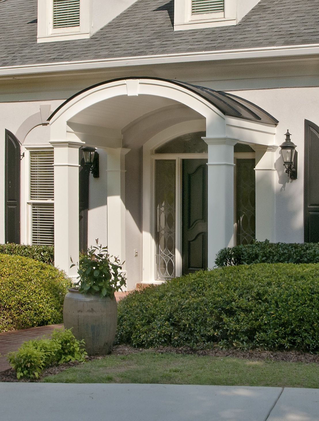 Elegant Arched Portico Addition On French Provincial Home