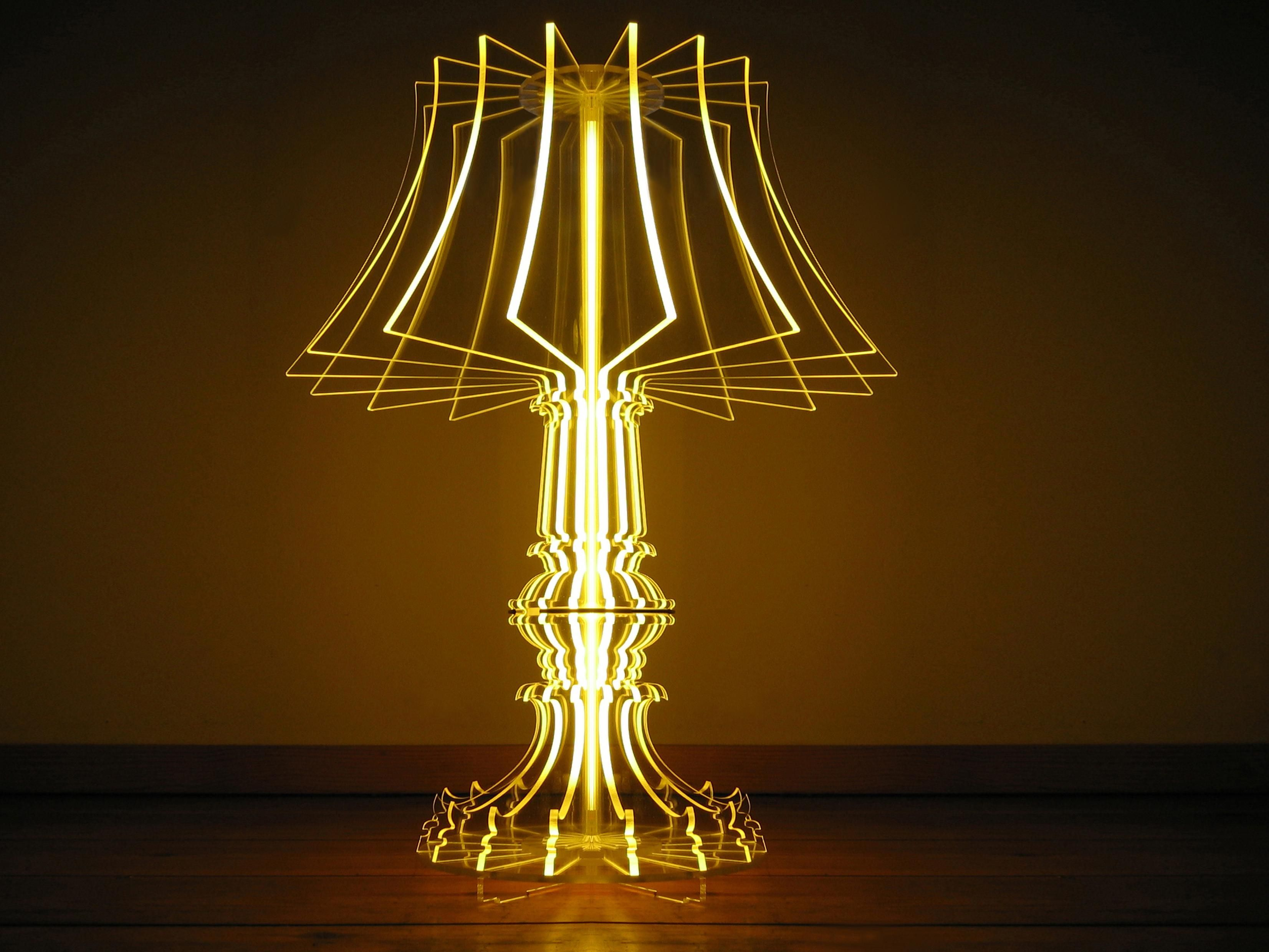 A modernist take on a traditional, old-world silhouette, this lamp is made with slices of clear acrylic, and...