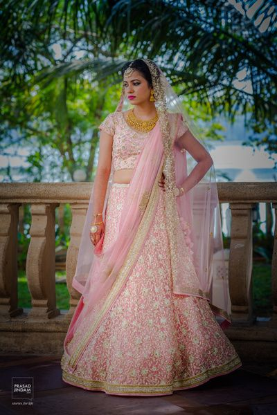 a8c77291d37f Bridal Colors - Pastel Lehenga - Bride in a Baby Pink Lehenga with White  Embroidery and Two Dupattas   WedMeGood #wedmegood #indianbride  #indianwedding ...