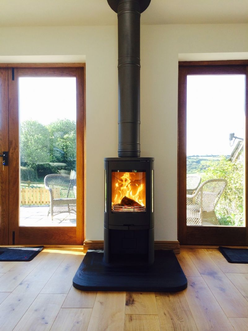 Kernow Fires Contura 850 between two doors wood burning stove installation  in Cornwall.