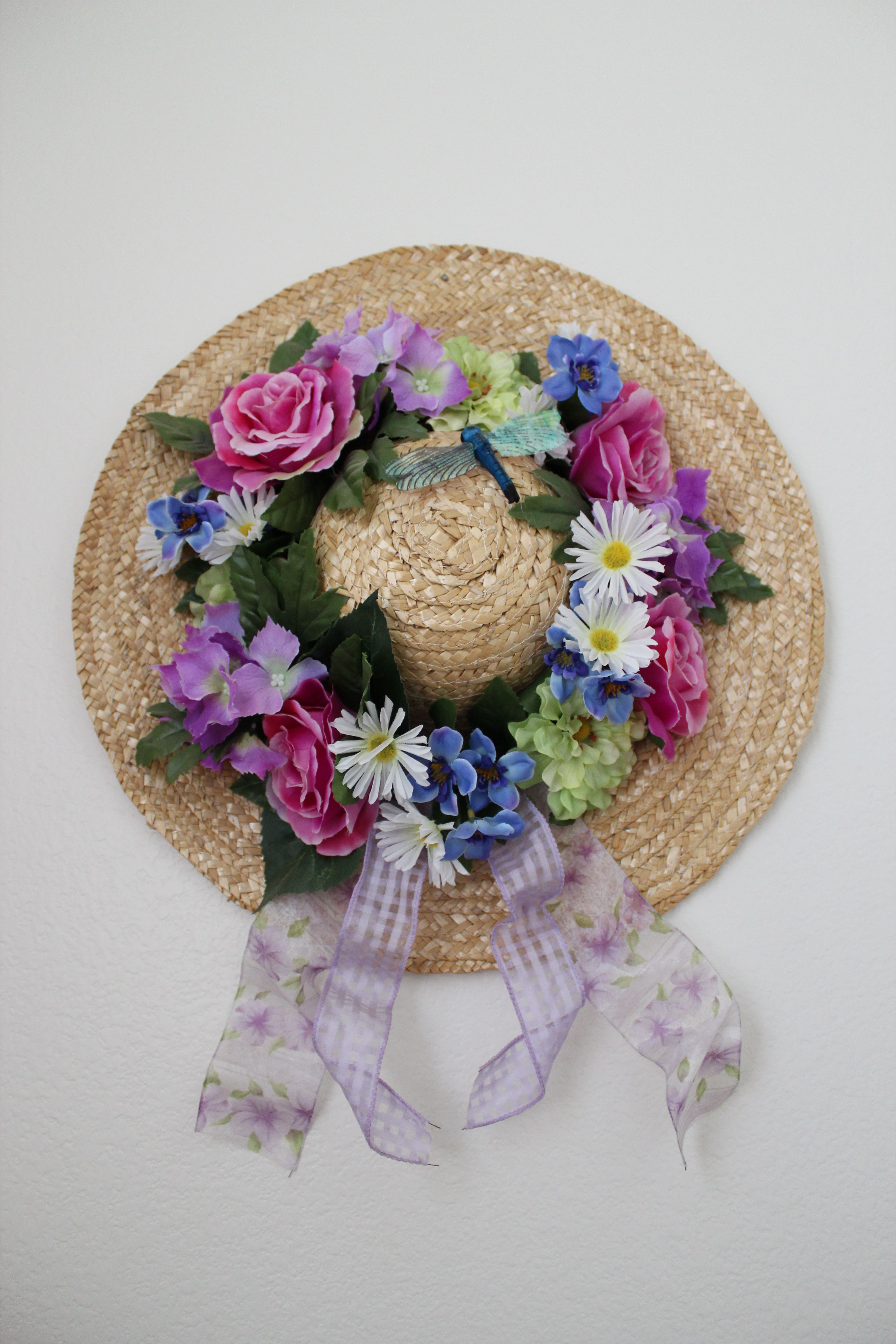 Straw Hat, Floral Bouquet, Ribbon, And Hot Glue Gun Wrapped The Ribbon