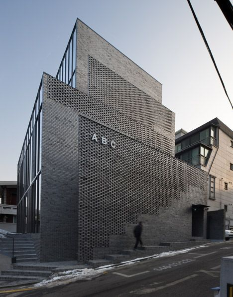 Perforated brick walls front this seoul office block for Perforated brick wall