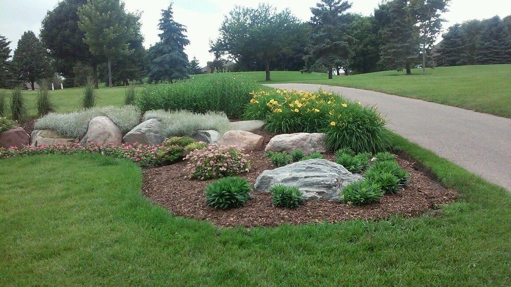 Decorative use of boulders in garden bed Yelp