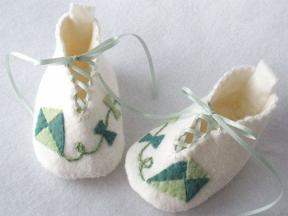 Soft baby booties in a white wool blend hand stitched felt with two tone kite applique are one of a kind. A very special gift for that
