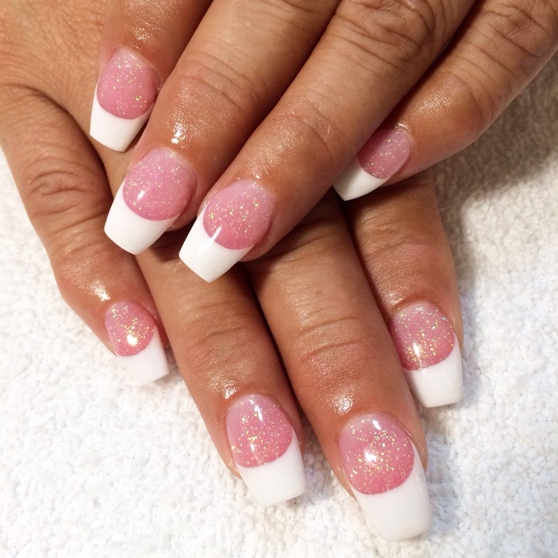 Pink and white French tip acrylic nails with glitter by ...