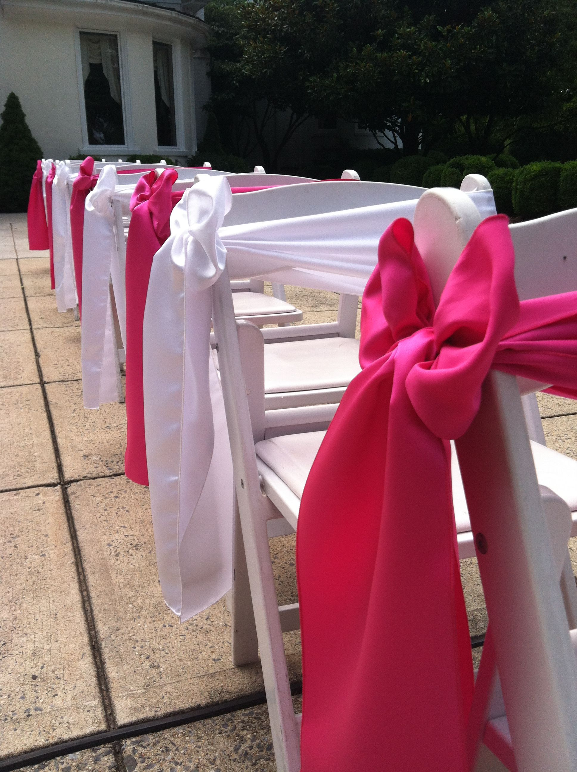 Hot Pink And White Satin Chair Sashes In A Side Box Alternating On White Resin Padded Folding Chairs Wedding Chair Sashes Wedding Rentals Wedding Chairs