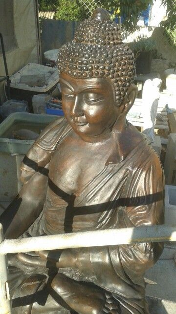 Life sized Buddha statue,  chocolate brown,  just completed.