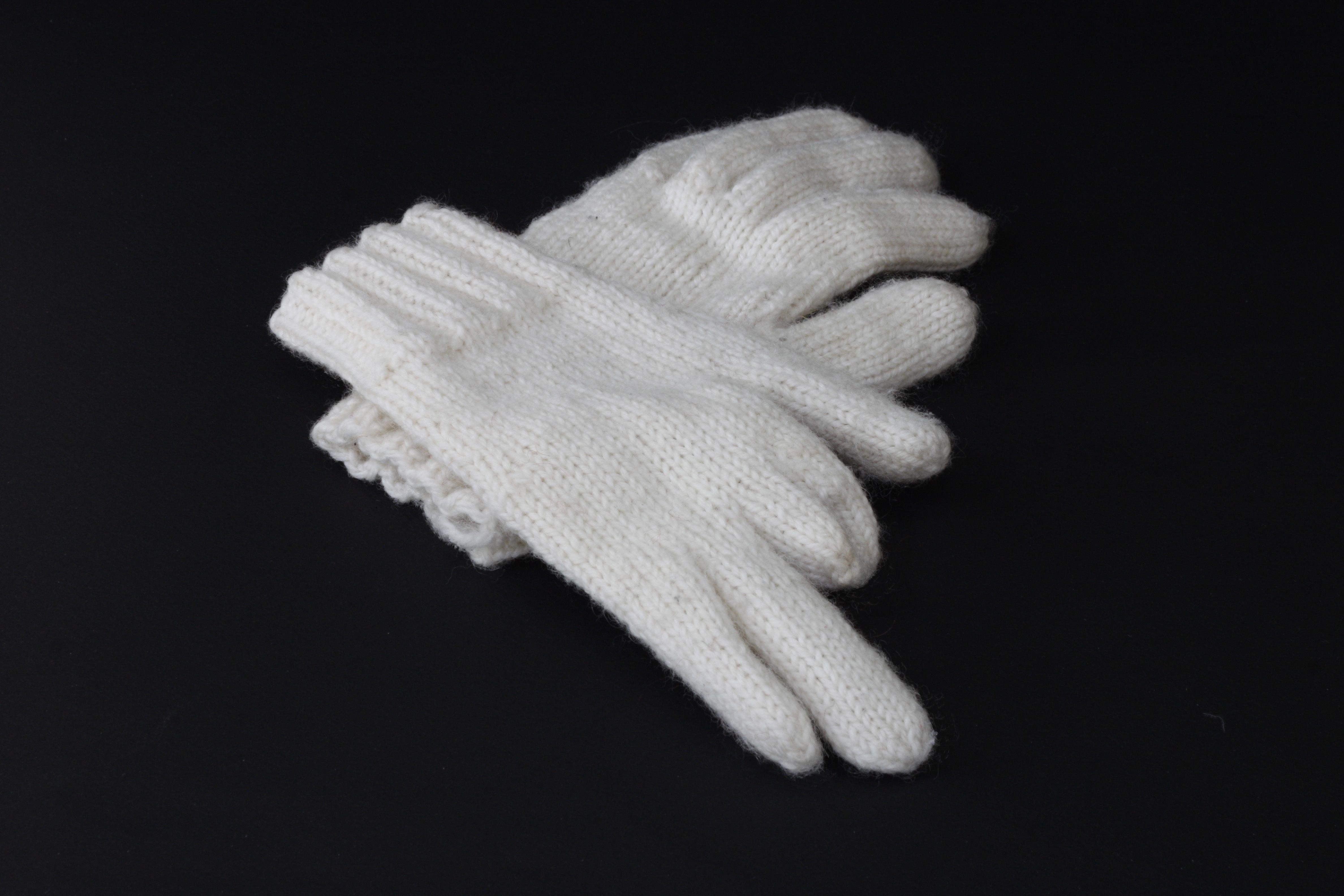 Finished gloves missing the upper part of two fingers on my right hand.