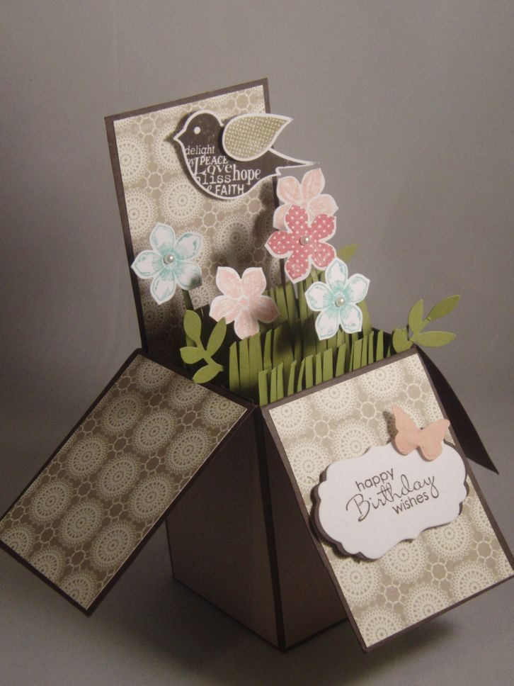 card in a box, grass, petite pansies, leaves, bird punch