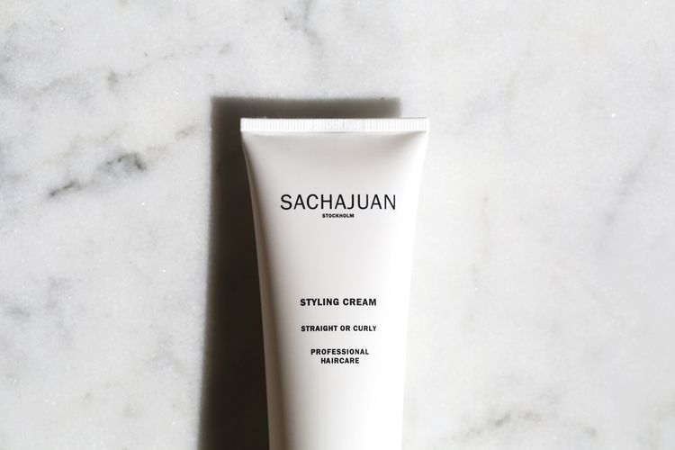 Sachajuan Styling Cream protects from heat styling, can be used on straight or curly hair. Leaves hair soft & silky.
