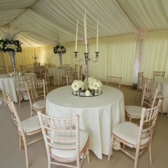 Limewash Chiavari Chairs With A Simple Floral Display And Impressive