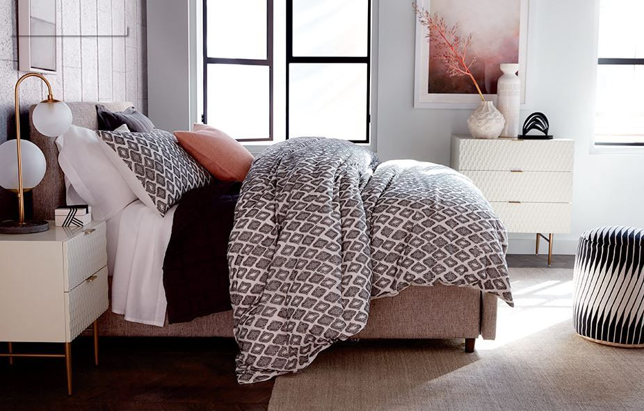Modern bedroom decor with salmon, grey, and beige colors
