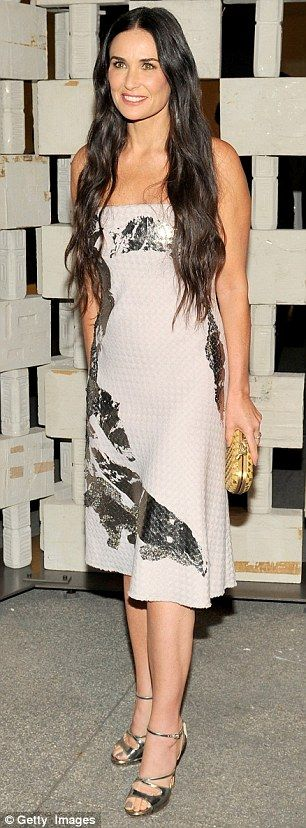 G.I. Jane: Ageless beauty Demi Moore looked incredible as always in a white and silver str...