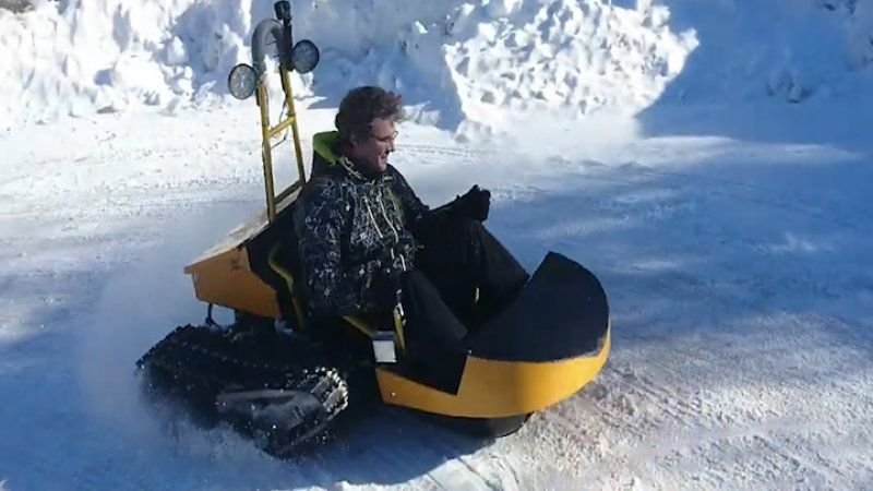 Electric powered snow sled with speeds reaching 28 mph tackles snow
