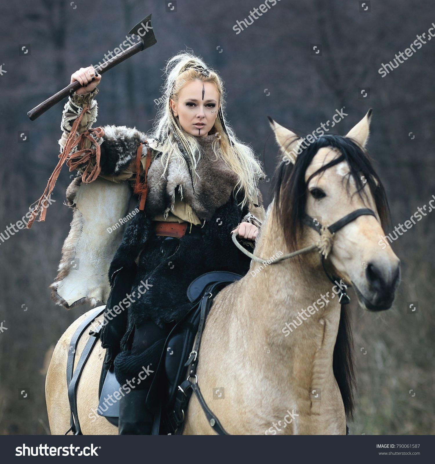 Beautiful Furious Scandinavian Viking Warrior Woman With War Makeup In Traditional Clothes Riding A Horse In Viking Warrior Woman Warrior Woman Viking Warrior
