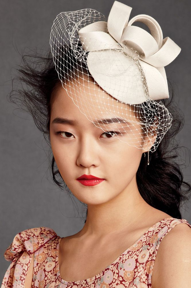 A coiled fascinator from BHLDN via Loverly