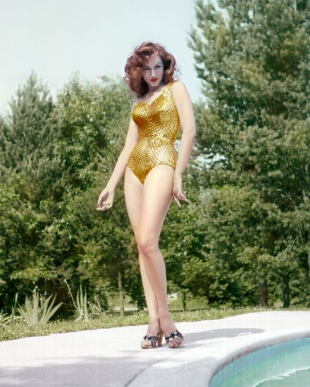 The fabulous Julie Newmar in a gold swimsuit Vintage Fashion Lingerie & Design z