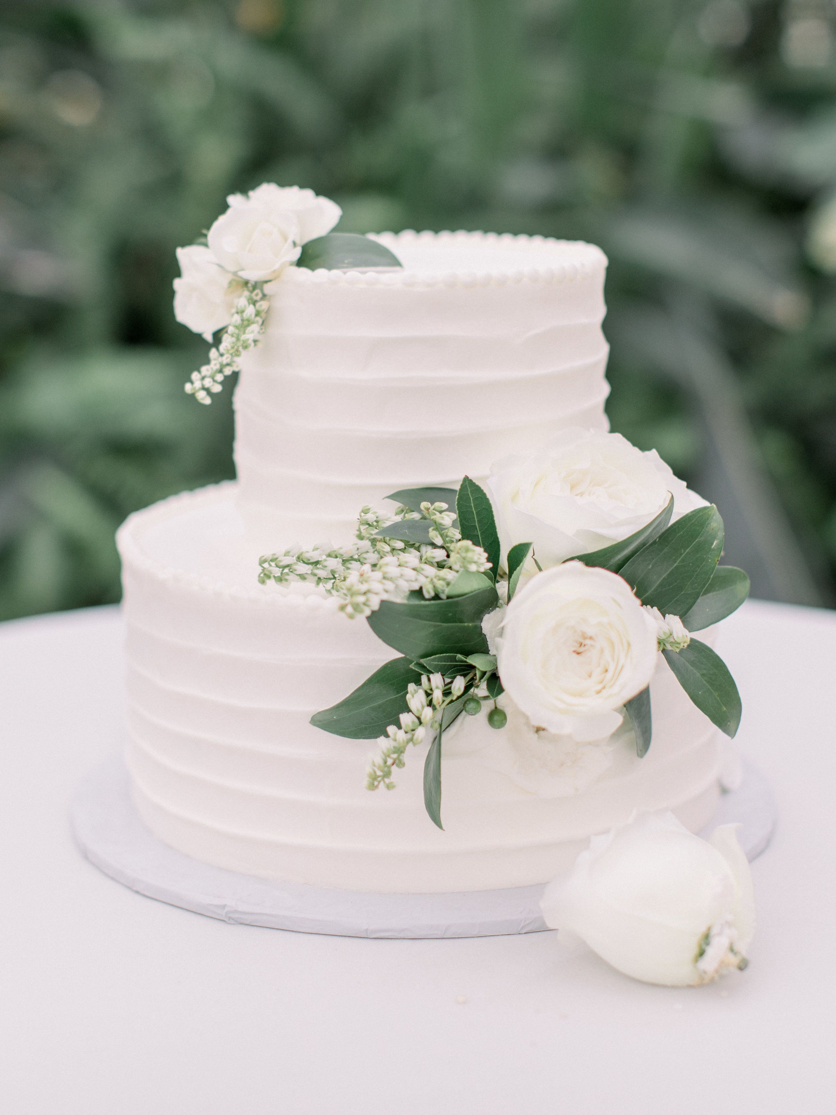 Simple And Elegant White Wedding Cake With White Flowers And