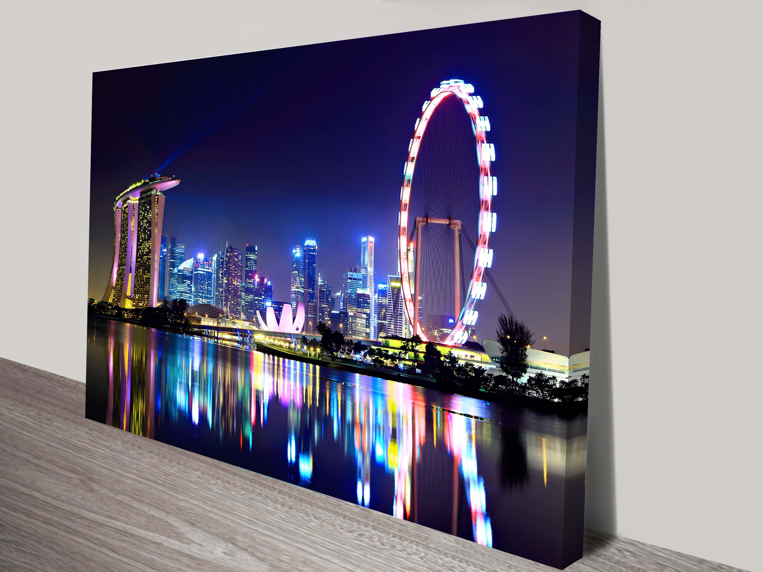 This is a stretched canvas print of the Singapore City Skyline at night