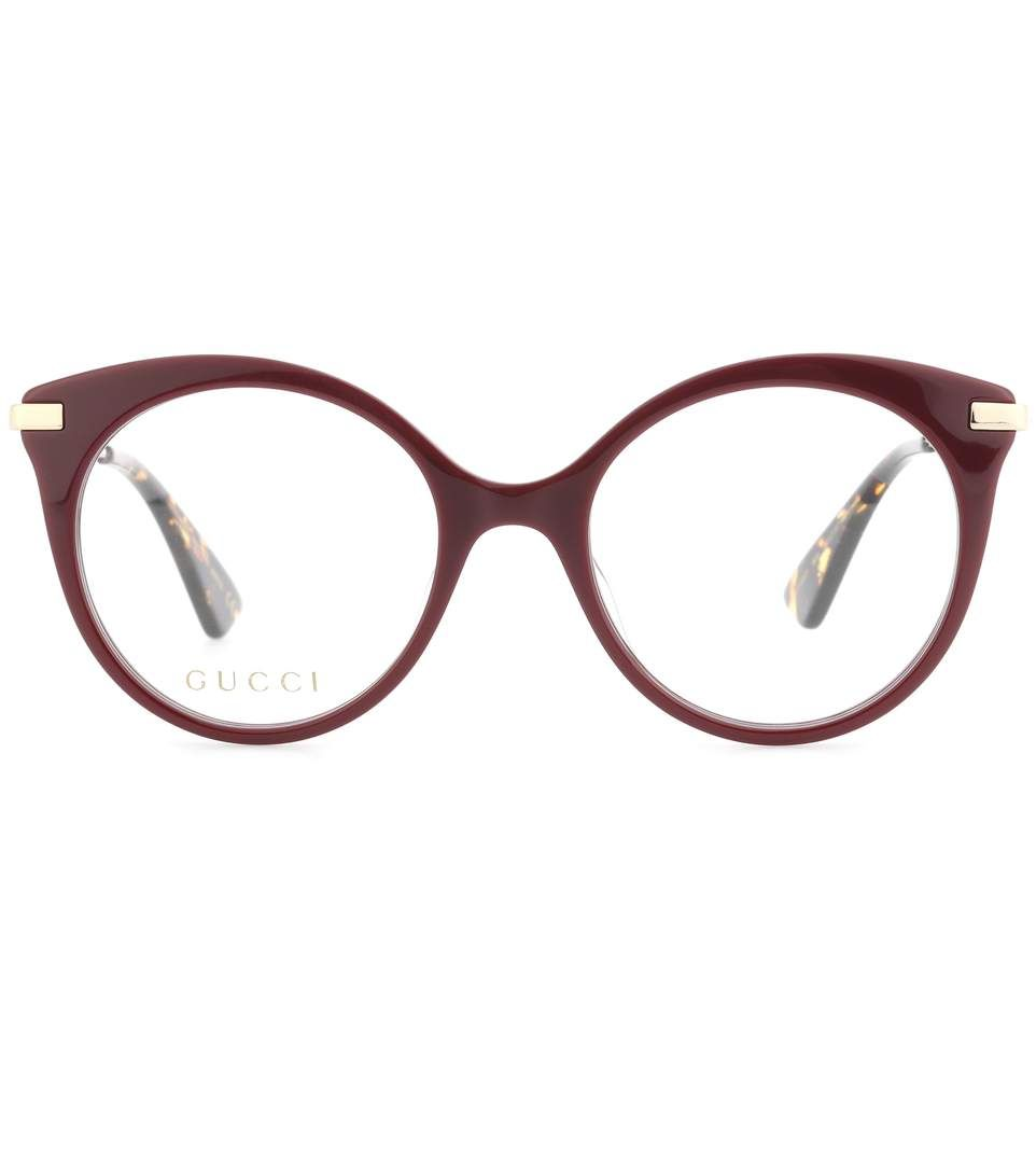 2be3e18c38 GUCCI - Round-frame glasses - Gucci s glasses come with large round frames  in a burgundy hue and create a retro look. The Japanese-made pair have  golden ...