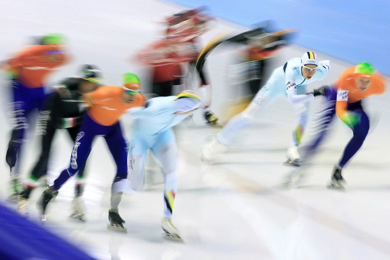 Description of . Bart Swings of Belgium, front left, looks at his brother Maarten, second right, during the men's mass start speedskating race of the World Cup final at Thialf skating arena in Heerenveen, northern Netherlands, Friday, March 14, 2014. (AP Photo/Peter Dejong)