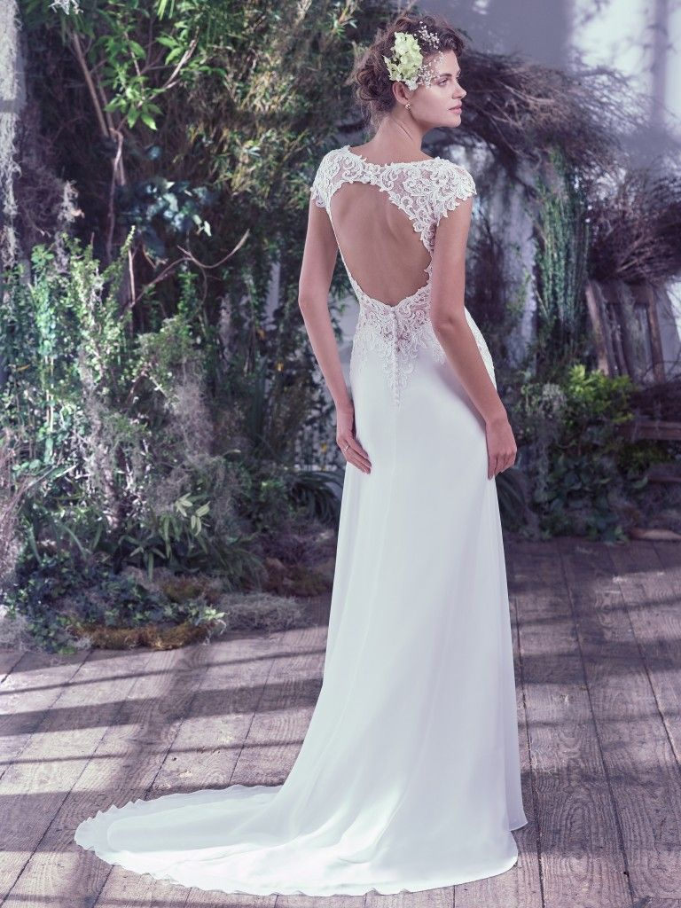 Vintage Glamour Is Exuded In This Sheath Wedding Dress With Bold Illusion Lace Plunging V Neckline And Romantic Cap Sleeves Naturally Falling