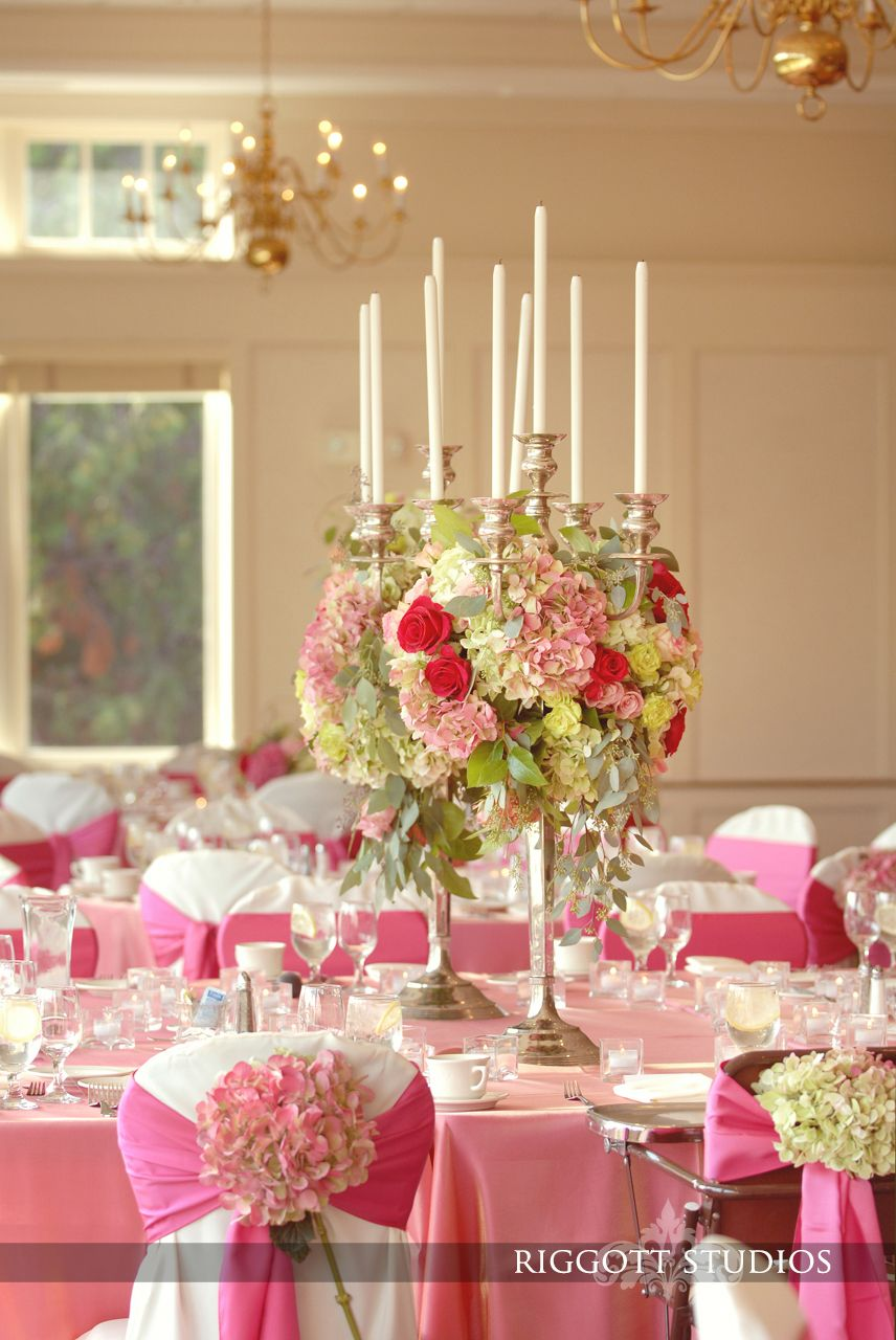 Beautiful wedding reception including pink ribbons bows
