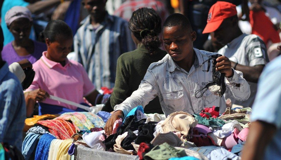 Africa Emerge With A Big Problem From Charities Companies Responsible For Clothes With Images Second Hand Clothes Africa Old T Shirts