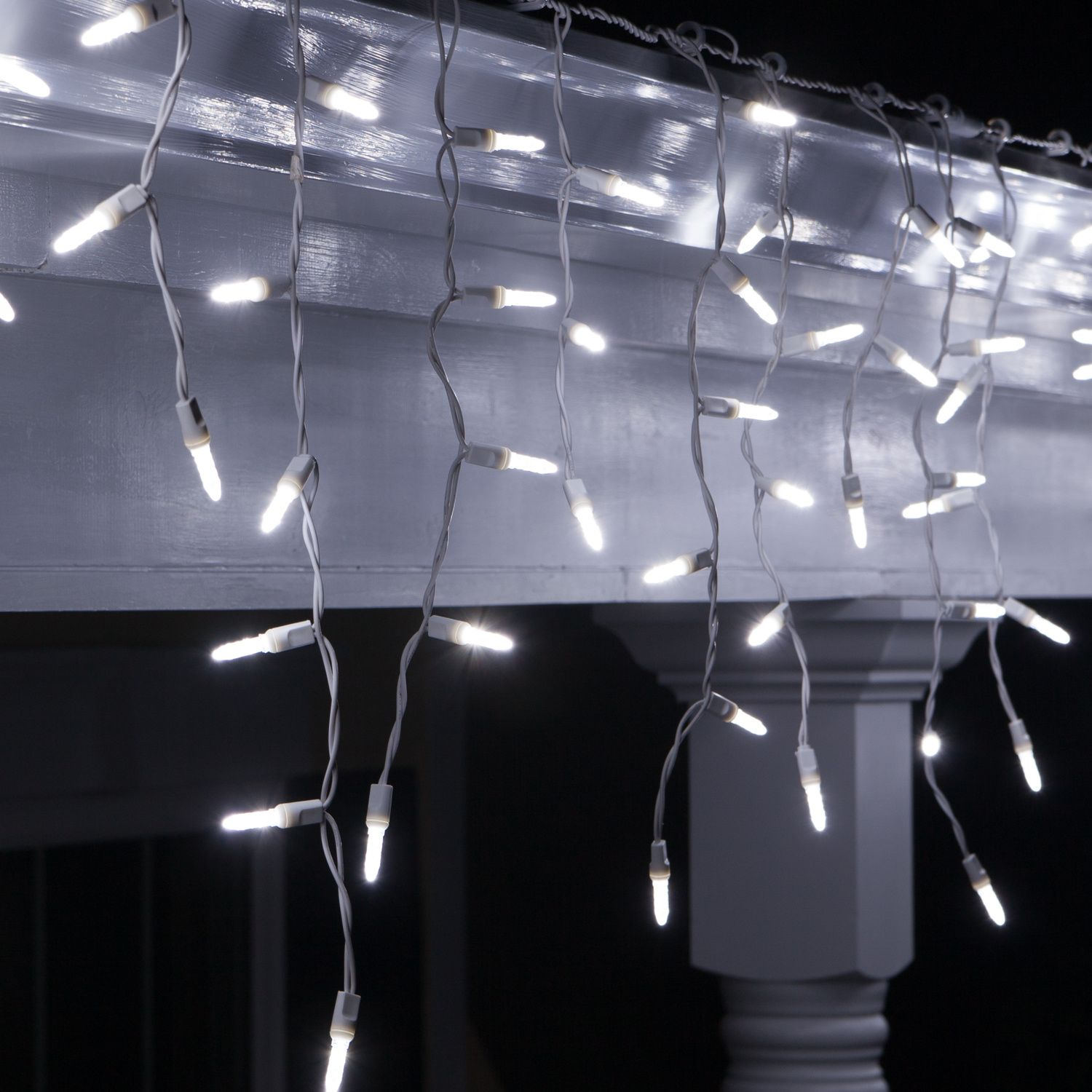 cool white twinkle led energy saving long lasting icicle lights on a l white wire with 3 inch spacing between drops makes hanging christmas lights easy