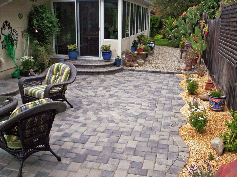 Patio paving stones photos interlocking paver designs for Small stone patio ideas