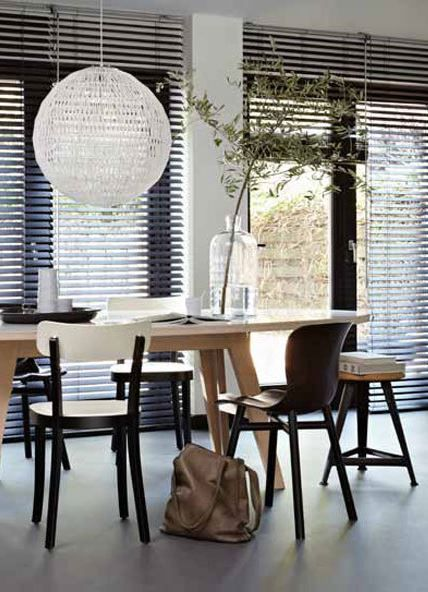 Wooden dining table with different types of wooden chairs. Also love ...