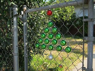 Decorated Chain Link Fence With Hanging Christmas Ornaments But