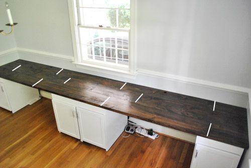 Long Wall Desk. Multiple Workspace. Looks Like Standard Cabinet Bases.