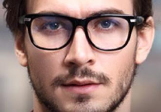 957fcc1e8c4 Young man with prescription eye glasses