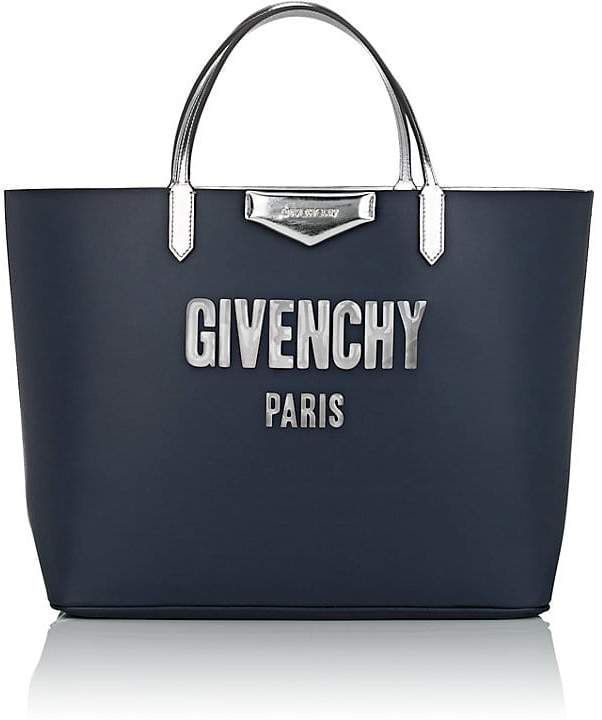 0ea46a44f2 Givenchy Women's Antigona Leather Tote Bag. Crafted of navy smooth calfskin,  Givenchy's pouch features clear logo bubble lettering at the front.