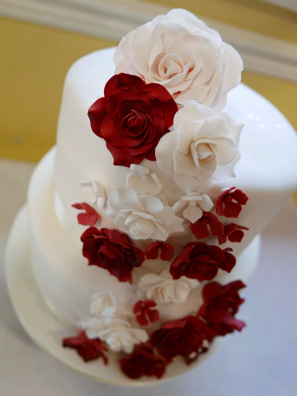 2 Tier Wedding Cake with red and white cascading sugar