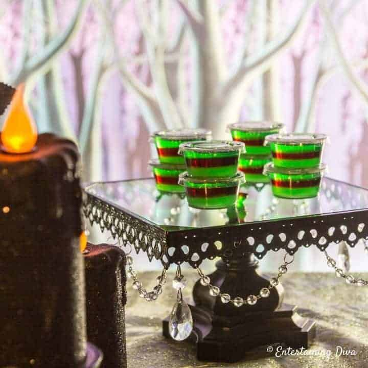 These purple and green layered jello shots are delicious! The recipe tells you exactly how to make layered jello shots and it's easier than it seems. These will be a big hit at my Halloween party.   Halloween Party