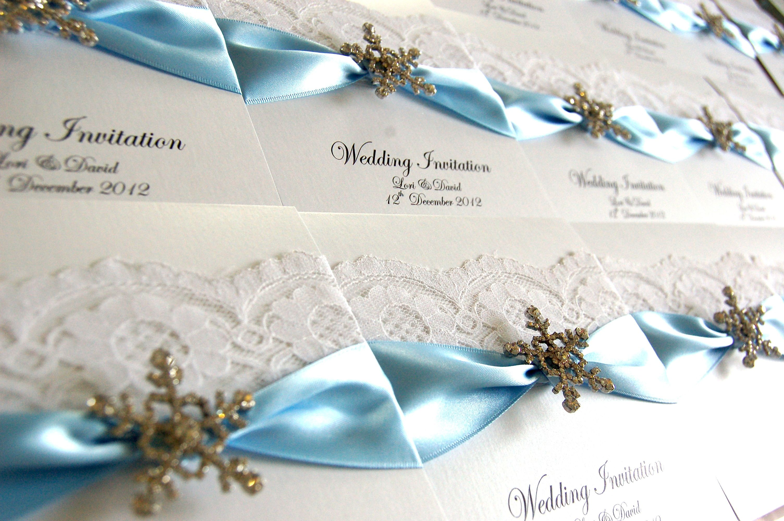 Snowflake wedding invitations in frosty blue shade, available at www ...