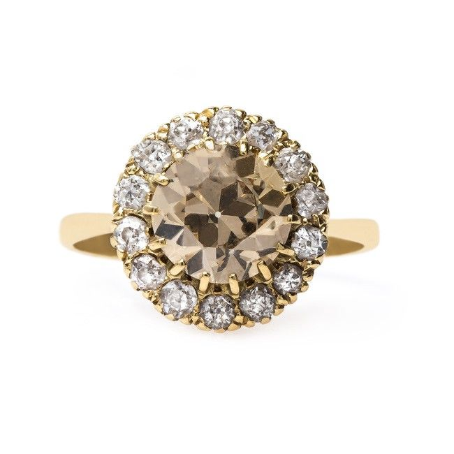 Amazing antique halo engagement ring with a Fancy Brown diamond // Carnegie Hall from Trumpet & Horn // $14,500