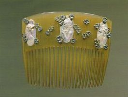 """Lalique 1900 """"Medallions and Pansies""""  Horn, enamel, ivory, gold. This comb resides at the Museu Calouste Gulbenkian, Lisbon."""