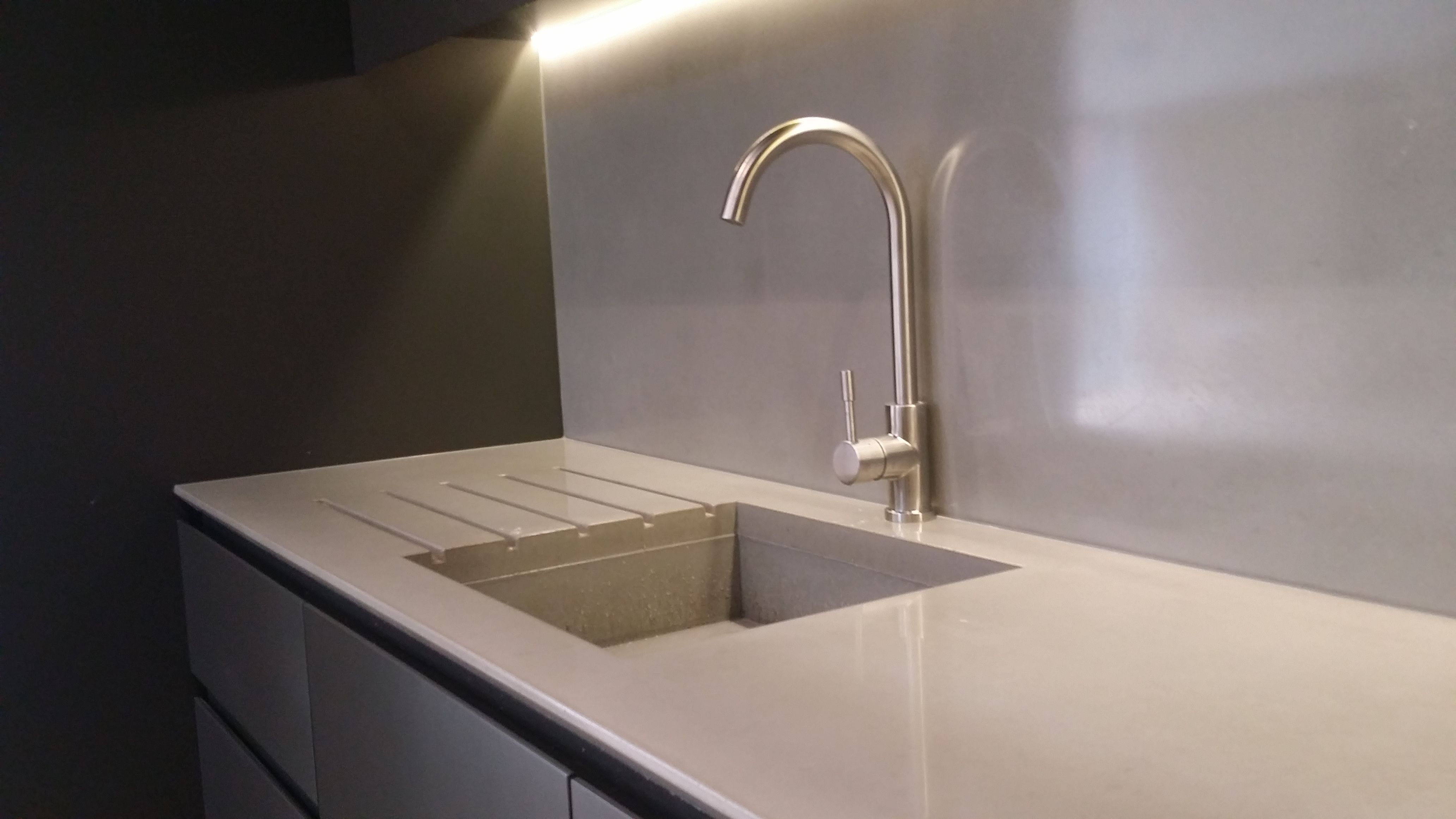 Polished concrete kitchen sink integrated with the same concrete ...