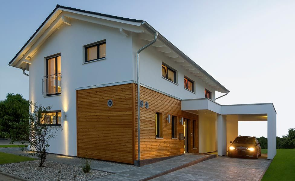 Moderne häuser satteldach holz  Modernes Einfamilienhaus mit Satteldach | Fertighaus Weiss ...