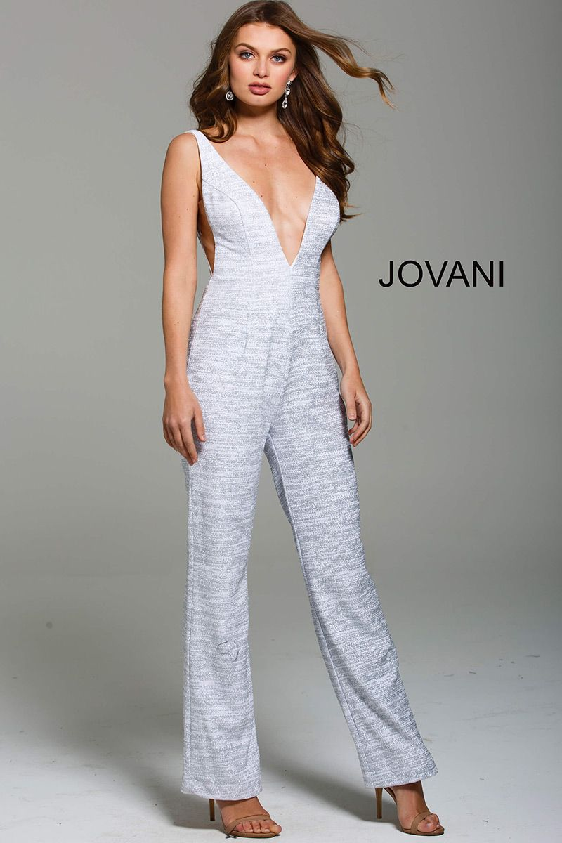 dd0c195fbe49 Style 56892 from Jovani is a Glitter Plunging V Neckline Prom Jumpsuit with  cut out sides and an open V back.